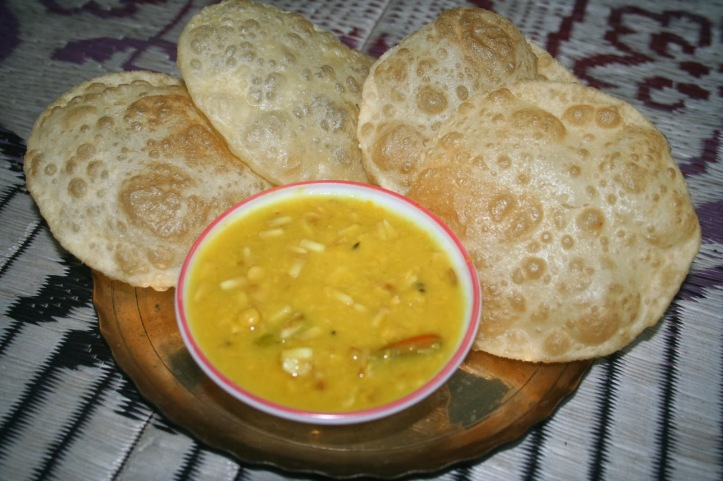 http://koyelichakraborty.blogspot.hk/2013/12/recipe-of-day-narkel-cholar-dal-chana.html